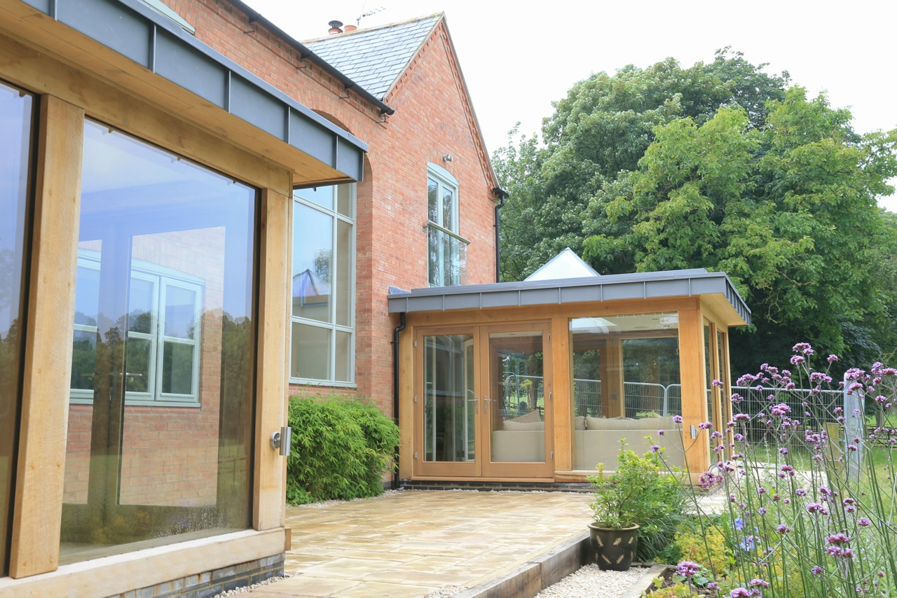 Contemporary oak frame design in alexton for Modern glass porch designs