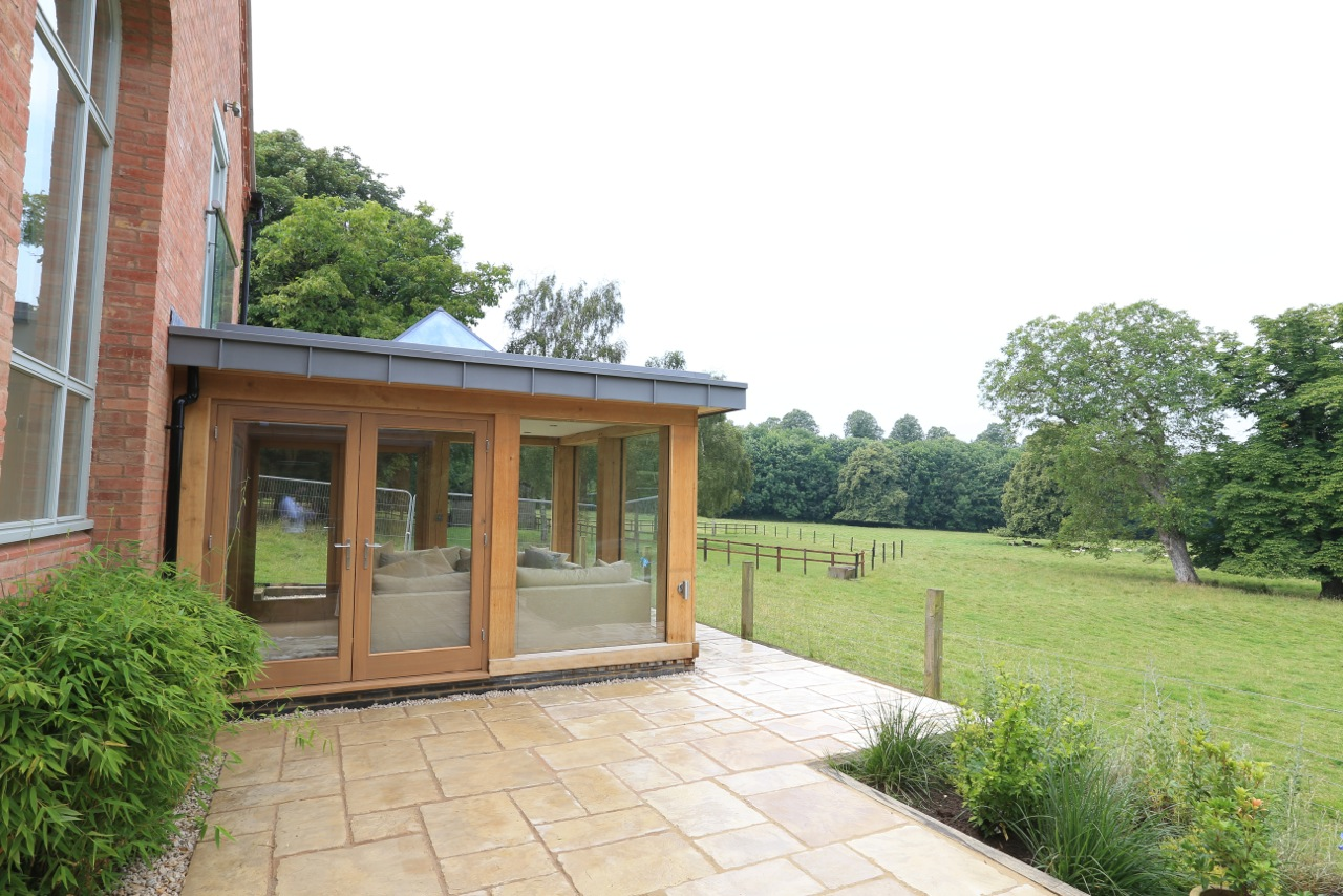 Contemporary oak frame design in alexton for Oak framed house designs